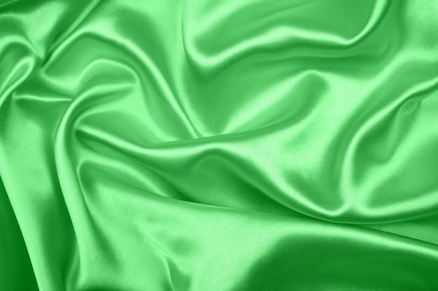 Liscio elegante seta verde o texture satinata può utilizzare come sfondo, bello del tessuto
