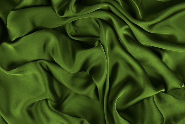 La seta elegante liscia o la trama satinata possono essere utilizzate come sfondo astratto. design di sfondo di lusso