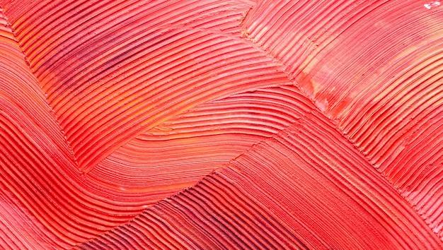 Fondo solido di struttura del rossetto opaco arancio rosso sbavato
