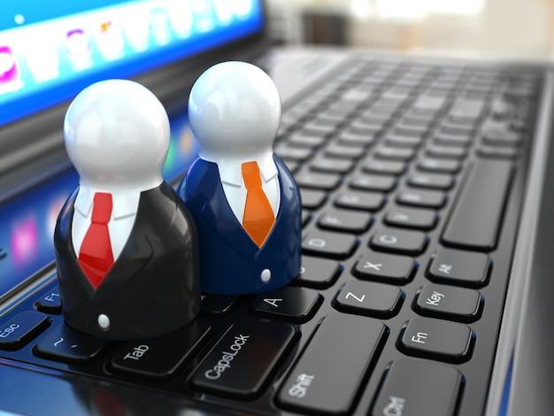 Concetto di social media. persone sulla tastiera del laptop. 3d