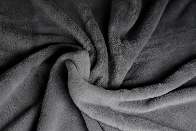 Sfondo in tessuto morbido trama coperta grigia motivo materiale ondulato