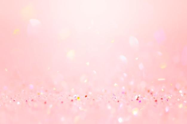 Sfondo bokeh di coriandoli glitter rosa tenue