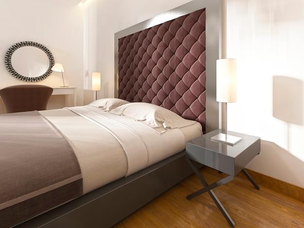 Testiera morbida e trapuntata, colore borgogna, struttura in metallo e comodini con lampade. rendering 3d.