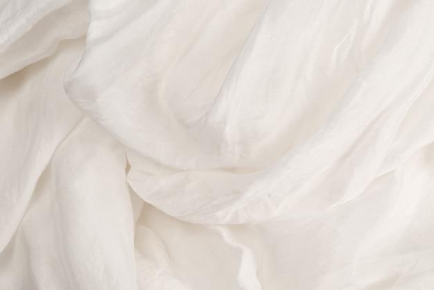 Sfondo morbido tessuto di seta bianco liscio. trama del tessuto.