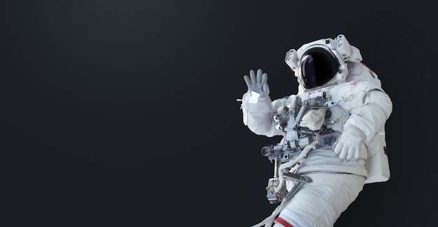 Spaceman su sfondo scuro isolato. carta da parati con l'astronauta. uomo spaziale con copyspace per testo e design