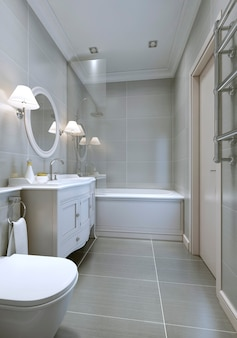 Spazioso bagno moderno con mobili classici, specchio rotondo