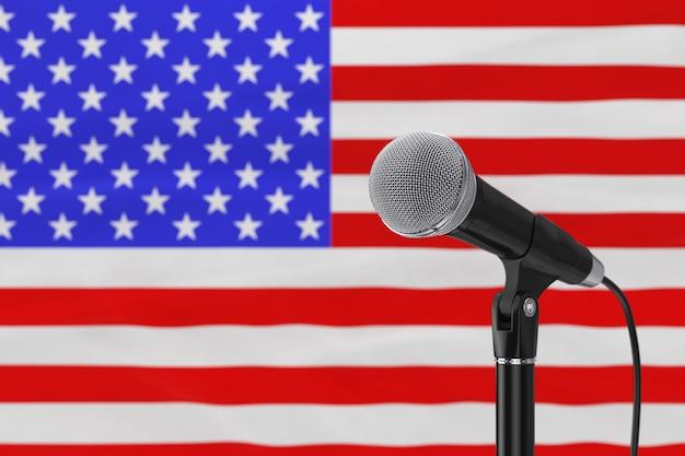 Discorso microfono stand contro sfocata bandiera usa primo piano estremo. rendering 3d