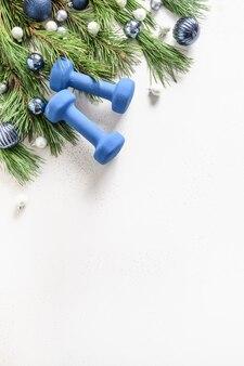 Cornice di natale sport con manubri blu