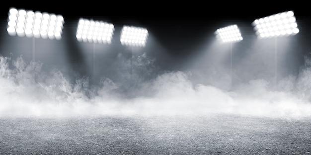 Arena sportiva con pavimento in cemento con sfondo di fumi e faretti