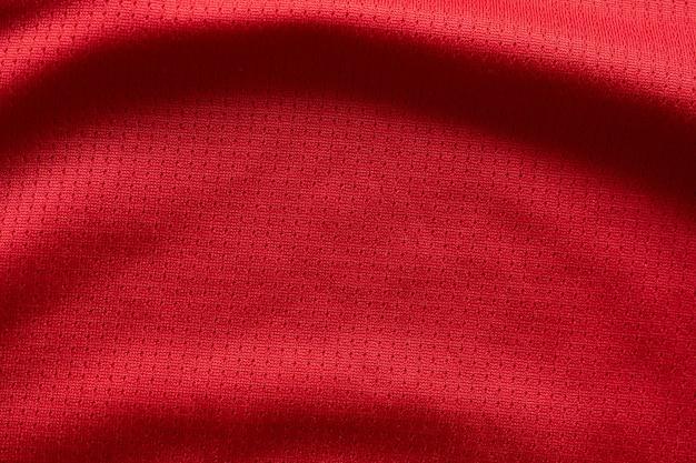 Colore rosso di vista superiore di struttura della maglia da calcio del tessuto dell'abbigliamento sportivo