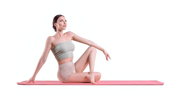 Giovane donna sportiva che fa pratica di yoga. il concetto di uno stile di vita sano e di un equilibrio naturale tra corpo e mente. pilates, stretching. tecnica mista