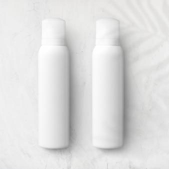 Mockup di flaconi spray per il marchio e l'imballaggio