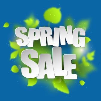 Tipografia di vendita di primavera foglie sfocate verdi su sfondo blu