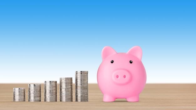 Impilamento di monete che crescono con salvadanaio rosa su sfondo blu