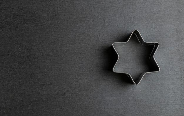 Tagliabiscotti stella di david su ardesia