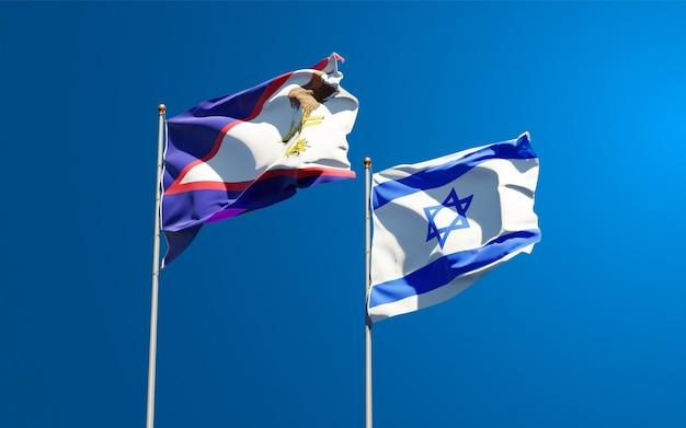Bandiere di stato di israele e samoa americane insieme sullo sfondo del cielo