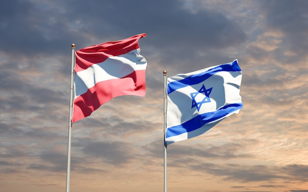 Bandiere di stato di israele e austria insieme sullo sfondo del cielo