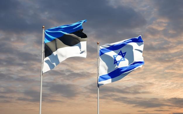 Bandiere di stato di israele ed estonia insieme sullo sfondo del cielo