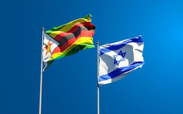 Bandiere di stato dello zimbabwe e israele insieme sullo sfondo del cielo