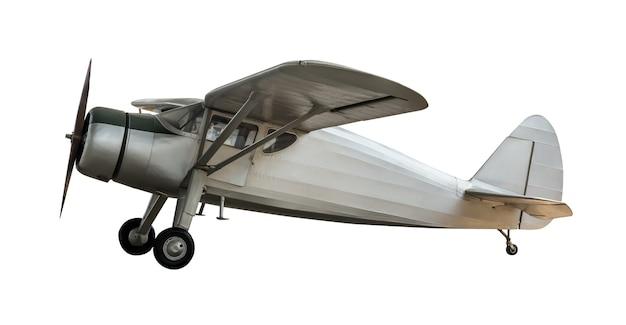 Aeroplano antico d'acciaio isolato su priorità bassa bianca