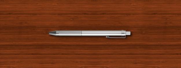 Penna in metallo d'acciaio isolata su legno scuro