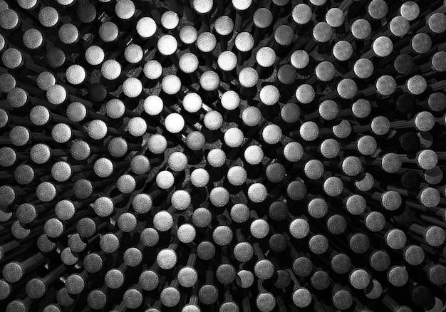 Fondo in acciaio cromato nero metallizzato e unghie d'argento. tecnologia industriale e concetto di struttura.