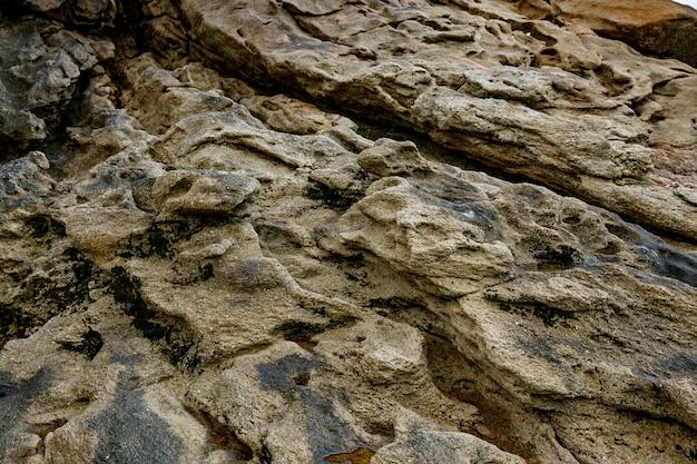 Sfondo di pietra. struttura della roccia del primo piano.