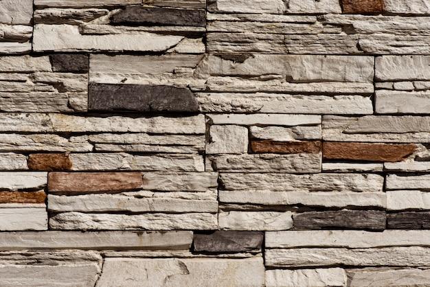 Muro di mattoni di pietra senza soluzione di continuità