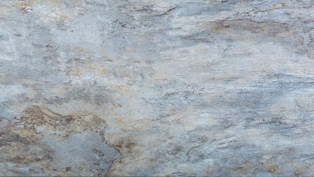 Pietra di granito sullo sfondo. sfondo con trame e motivi di pietra e roccia naturale, granito o marmo.