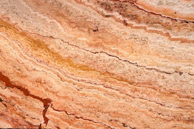 Piastrella in travertino di pietra, tessitura. materiale decorativo naturale.