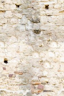Muro di pietra per lo sfondo, struttura di colore naturale della pietra senza soluzione di continuità