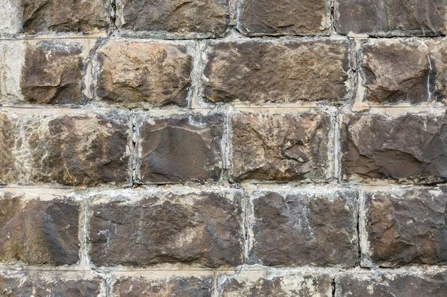 Struttura della muratura di pietra del fondo del muro di pietra di un muro di pietra