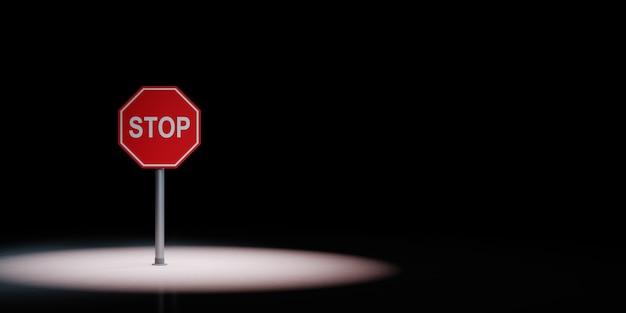 Segnale stradale di arresto sotto i riflettori isolato