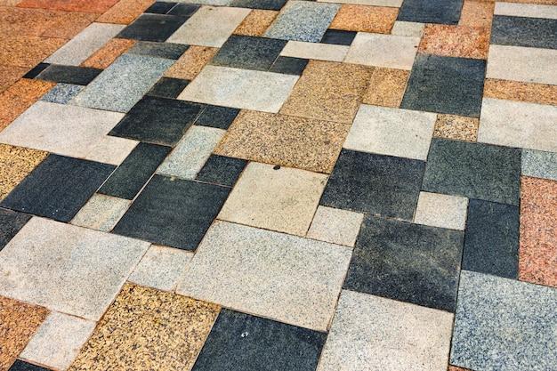 Piastrelle strutturate del pavimento della strada come sfondo