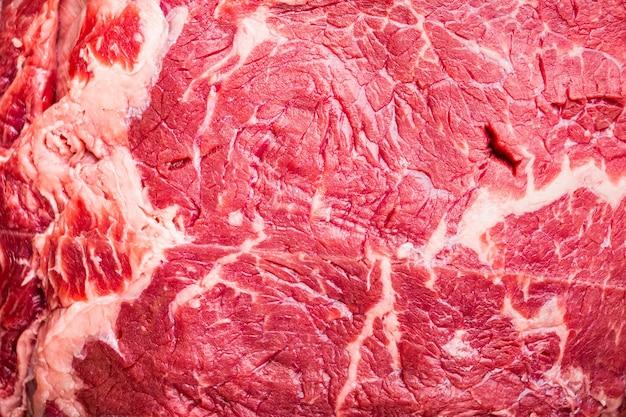 Bistecca di manzo, carne cruda di manzo marmorizzata, vista dall'alto