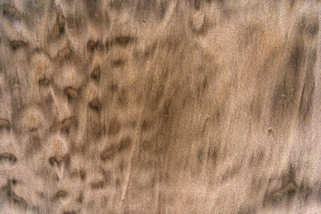 Sabbia a strisce su una spiaggia della california sabbia dorata con una mescolanza di sabbia nera motivo sulla sabbia