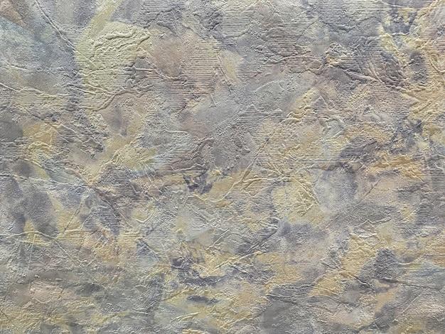 Struttura di fondo astratto sotto forma di un intonaco irregolare ruvido di colore marrone grigio.
