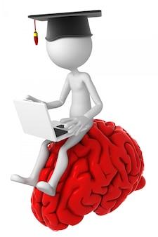Studente con il computer portatile che si siede in cima al cervello.