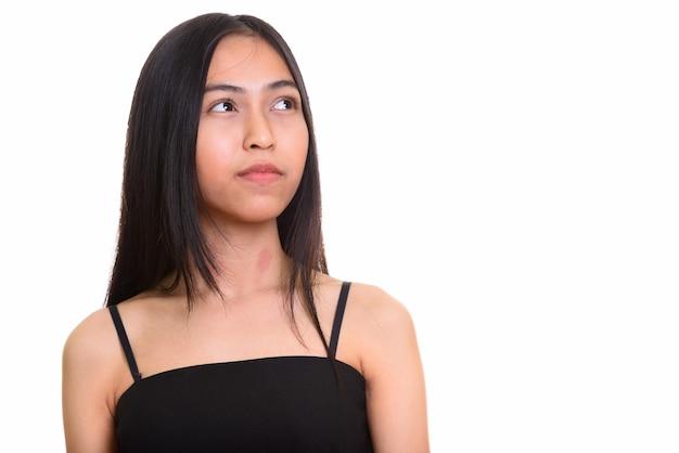 Studio shot di giovani asiatici ragazza adolescente