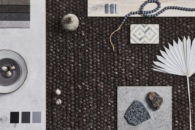 Elegante composizione piatta di moodboard per architetti con campioni di edifici, tessuti marroni e materiali naturali e accessori personali. vista dall'alto, modello.