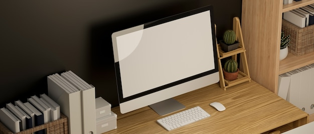 Elegante mockup di spazio di lavoro domestico in un mockup di schermo bianco del computer interno contemporaneo minimale