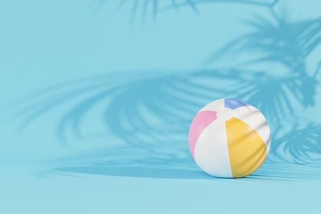Superficie blu estiva con palloni da spiaggia gonfiabili e ombre di foglie tropicali