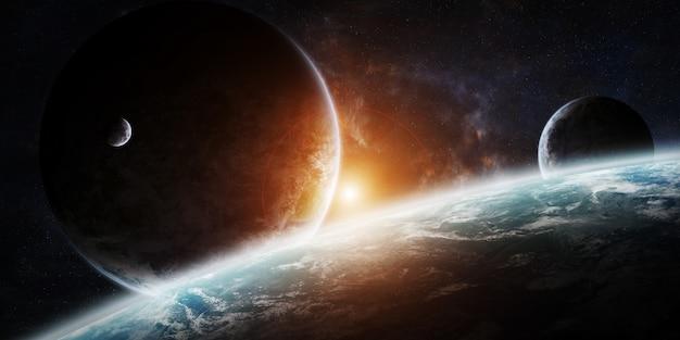 Alba sopra un gruppo di pianeti nello spazio