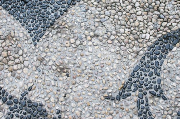 La superficie delle numerose pietre di fiume. ottimo per il design e lo sfondo della trama. astrazione in natura.