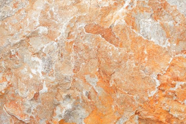 Superficie del marmo con tinta marrone, struttura di pietra e sfondo