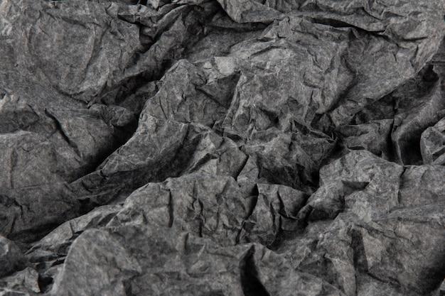 Superficie con texture di carta grigia stropicciata.