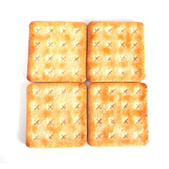 Biscotti o biscotti dolci del cracker su fondo, concetto di alimento.