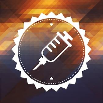 Icona della siringa. design dell'etichetta retrò. sfondo hipster fatto di triangoli, effetto di flusso di colore.