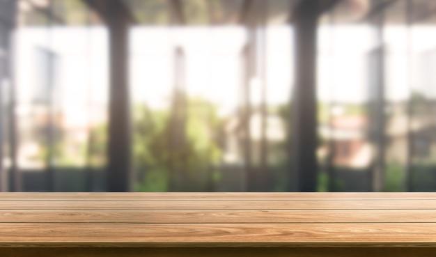Tabella nella priorità bassa della città dell'ufficio moderno con lo spazio vuoto della copia sul tavolo per il modello di visualizzazione del prodotto.