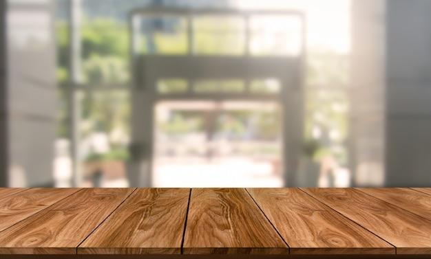 Tavolo nella moderna città ufficio con spazio vuoto della copia sul tavolo per il mockup di visualizzazione del prodotto.